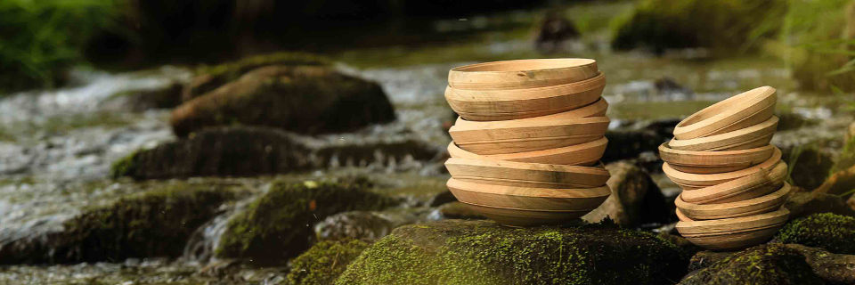 2 stacks of bowls by a stream